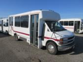 2001 Champion Chevrolet 12 Passenger and 2 Wheelchair Shuttle Bus Passenger side exterior front angle-08546-1