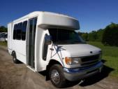 2000 Goshen Coach Ford 12 Passenger and 2 Wheelchair Shuttle Bus Passenger side exterior front angle-09283-1